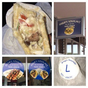 lamb souvlaki half eaten, greg souvlaki blue building sign, blue circle sign in glass window, greg souvlaki label on take away bag