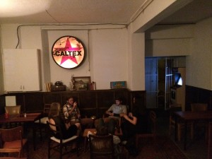 Dining room with illuminated Caltex sign on wall