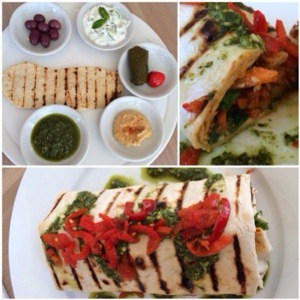 flat bread with tatziki, olives, pepperdew, dolmades, hummus, pesto and a chicken wrap with grill marks.