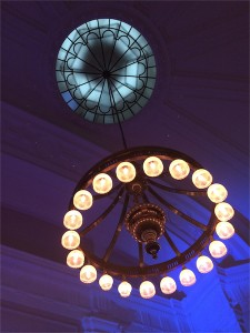 glass circle ceiling with chandelier with round lights