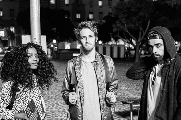 black woman and two white men in black and white photograph