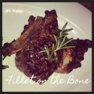 grilled fillet on the bone with rosemary twig