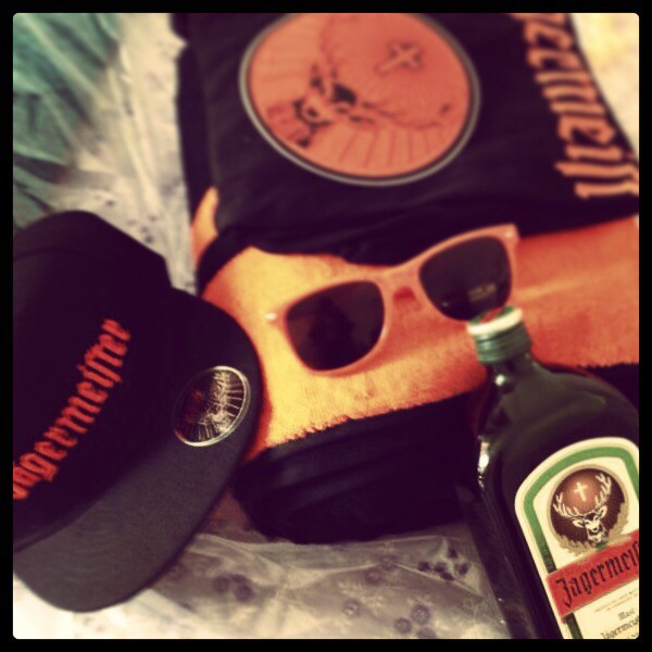 Jagermeister black cap, orange sun glasses, orange blankets, jagermeister bottle, black and orange t-shirt