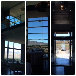 large glass windows with views of blue skies