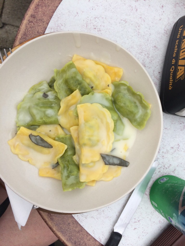 bowl of green and yellow raviolli