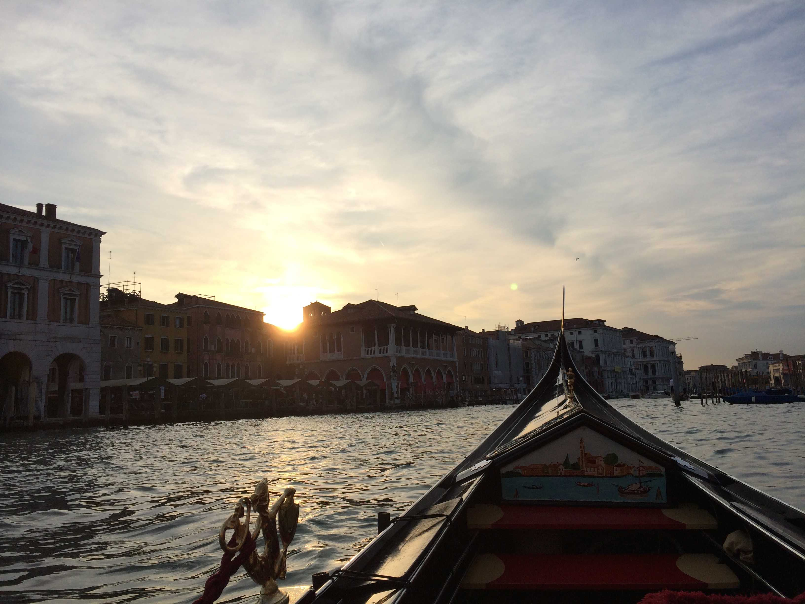 Gondola ont he water in venice at sunset