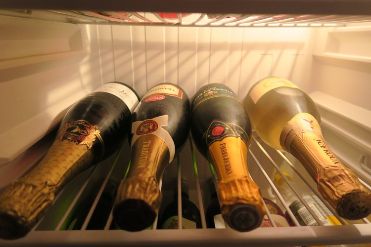 champagne bottles in a fridge
